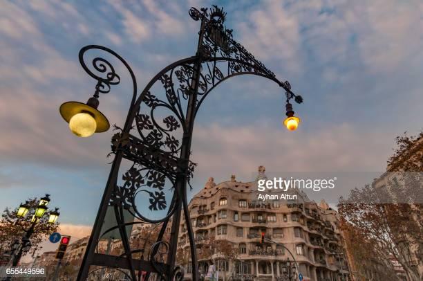 Art Nouveau Street Lamp and La Pedrera (Casa Mila) in Barcelona,Spain