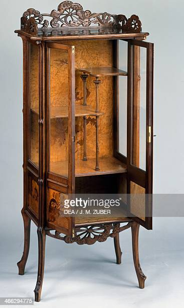 Art Nouveau style carved walnut display cabinet 18901900 by Emile Galle France early 20th century