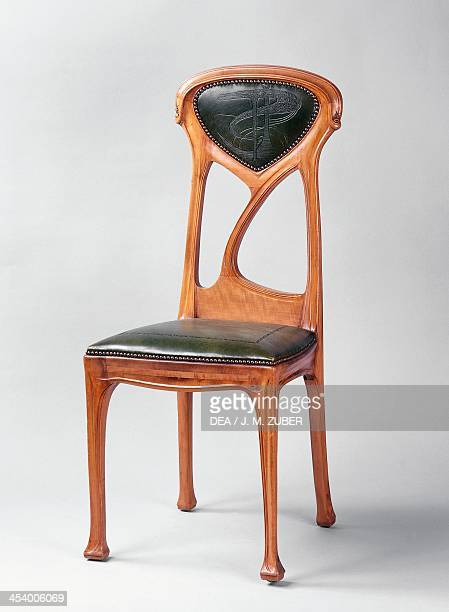 Art Nouveau style chair by Hector Guimard carved pear wood France 20th century