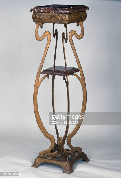 Art Nouveaustyle bronze stand with two marble tops and decorated with poppies 18901900 France 19th century