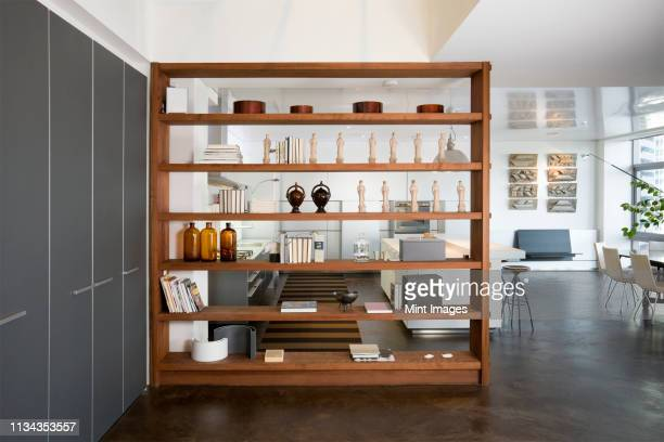 art objects on wooden shelving - 棚 ストックフォトと画像