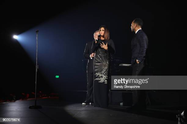 Art of Elysium's chairman of the board Tim Headington and founder Jennifer Howell present John Legend with the Visionary Spirit of Elysium award at...