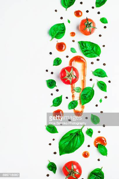 Art of food patterns (with tomato ketchup and basil leaves)