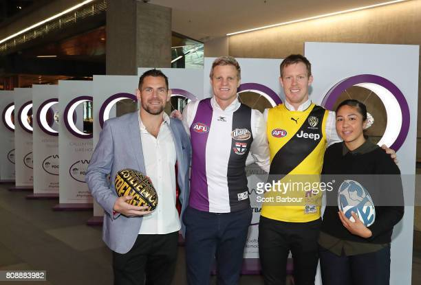 'Art of Football' supporters Luke Hodge and Darcy Vescio pose with Nick Riewoldt and Jack Riewoldt during the 'Art of Football' exhibition on July 5...