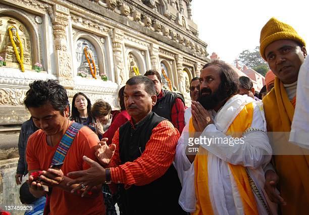 Art of Living Foundation leader Shri Ravi Shankar also known as 'Sri Sri' offers prayers at Mahabodhi temple in Bodhgaya on January 21 2012 He is a...