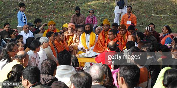Art of Living Foundation leader Shri Ravi Shankar also known as 'Sri Sri' attends a medation session in front of the holy Mahbodhi tree in Bodhgaya...