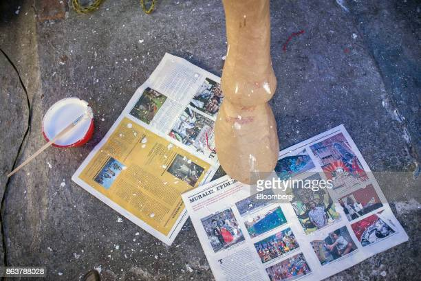 Art paste sits on the floor next to an alebrije Mexican folk art sculpture in the process of being created at a studio in Mexico City Mexico on...