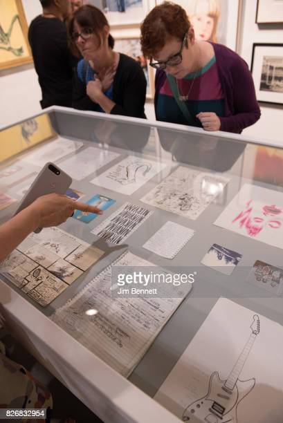 Art patrons examine a collection of Kurt Cobain's notes drawings and other memoribilia including the written lyrics for Smells Like Teen Spirit at...