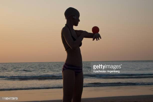 art performer at sunset, goa - argenberg stock-fotos und bilder