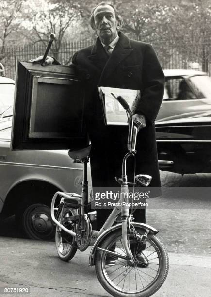 17th November 1967 Spanish surrealist painter Salvador Dali pictured delivering one of his paintings to a Paris exhibition having arrived by bicycle...