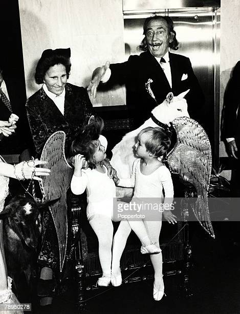 1971 Paris Spanish surrealist painter Salvador Dali pictured with his wife Gala and two little angels at one of his exhibitions Salvador Dali who...