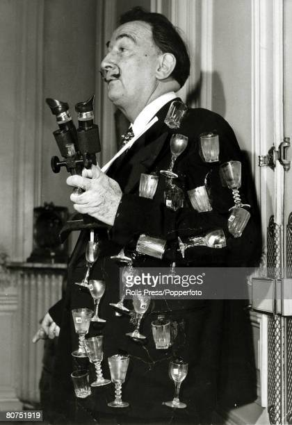 1971 Paris Spanish surrealist painter Salvador Dali pictured in his usual uninhibited style with a jacket covered in glasses and a microscope to help...