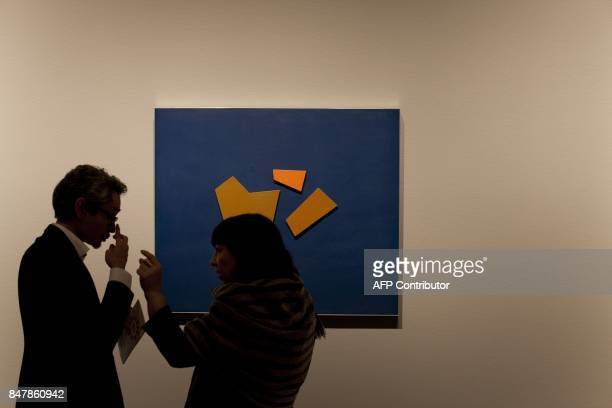 Art professionals discuss the artwork at at the Getty Museum's Pacific Standard Time LA/LA exhibit opening celebration in Los Angeles on September 15...