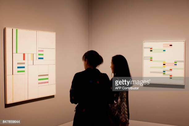 Art professionals look at the artwork at the Getty Museum's Pacific Standard Time LA/LA exhibit opening celebration in Los Angeles on September 15...