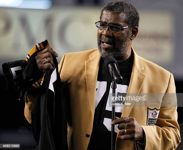 Art Rooney II presents Joe Greene with a jersey after having his number retired from the Pittsburgh Steelers organization on November 2 2014 against...