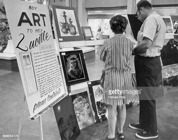 Art Sale Assist Unconscious Coed Mr and Mrs Lloyd Edraney 5091 S Clinton St Arapahoe County look over some of the 50 paintings on sale Saturday at...