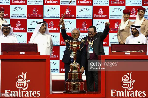 Art Sherman trainer of California Chrome celebrates with the trophy after victory in the Dubai World Cup Sponsored By Emirates Airline as part of the...
