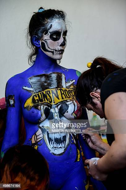 Art students of the Chilean institute AIEP paint the body of a professional model during an exhibition of body painting during which they showed more...