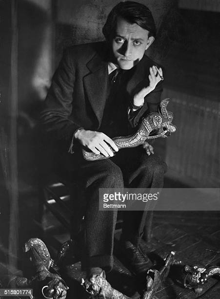 Art theorist political activist and future Minister of Cultural Affairs under de Gaulle Andre Malraux is seen holding sculptures he took from a Khmer...