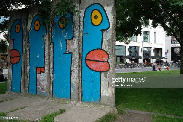 Art work appears on a section of the Berlin Wall preserved as memoribilia of the Cold War is placed in a park near Potsdamer Platz on July 14 2017 in...