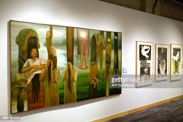 Art work by Ivan Sagita and Mauricio Lasansky are displayed at the Take A Stand Center at the Illinois Holocaust Museum Education Center on Thursday...
