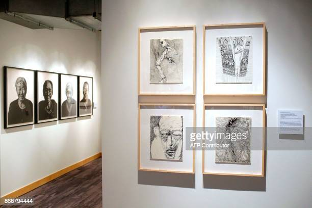 Art work by WonChul Jung and Rosemarie Koczy are displayed at the Take A Stand Center at the Illinois Holocaust Museum Education Center on Thursday...