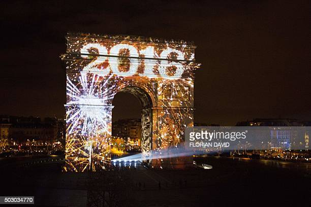 Art work is projected on Arc de Triomphe during a sound and light show part of New Year's celebrations on the ChampsElysees avenue in Paris on...