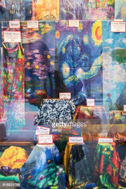 art works on scarves in paris shop window - impressionism stock photos and pictures