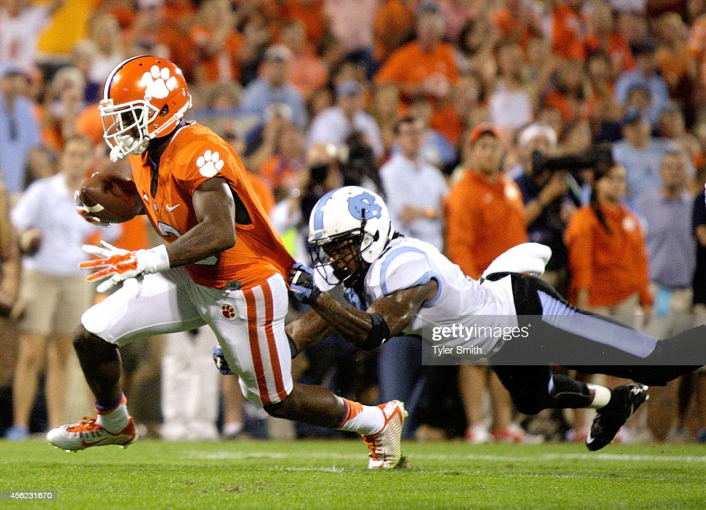 Artavis Scott #3 of the Clemson Tigers lunges for a touchdown during the game against the North Carolina Tar Heels at Memorial Stadium on September 27, 2014 in Clemson, South Carolina.