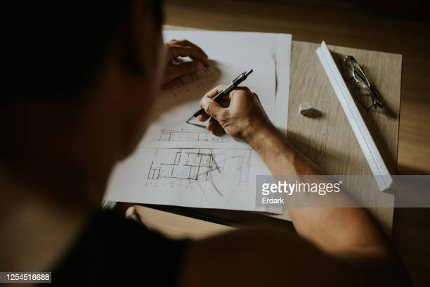 artchitect freelancer man drawing and designing home - sketch stock pictures, royalty-free photos & images
