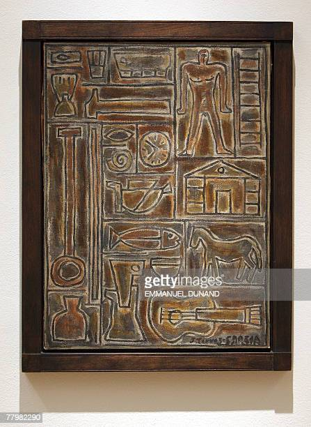 """""""Arte Constructivo Con Guitarra"""" by Uruguayan artist Joaquin Torres Garcia is on display at Sotheby's auction house in New York, 19 November 2007...."""