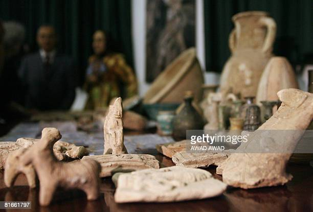 Artefacts looted from Baghdad museum after the USled invasion of 2003 are displayed during a press conference held by JordanIian Tourism and...
