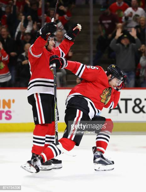 Artem Anisimov and Patrick Kane of the Chicago Blackhawks celebrate Anisimovs' second goal of the game against the New York Rangers at the United...