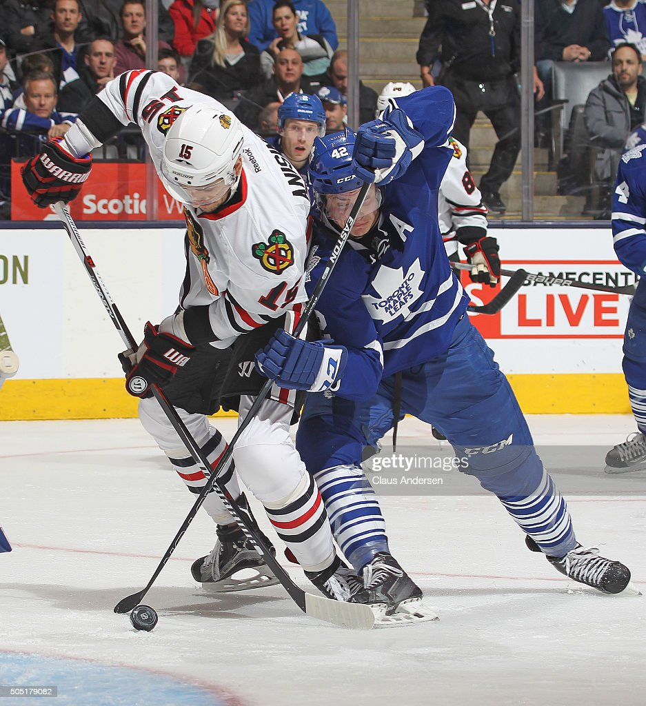 Artem Anisimov #15 of the Chicago Black Hawks skates against Tyler Bozak #42 of the Toronto Maple Leafs during an NHL game at the Air Canada Centre on January 15, 2016 in Toronto, Ontario, Canada. The Black Hawks defeated the Maple Leafs 4-1.