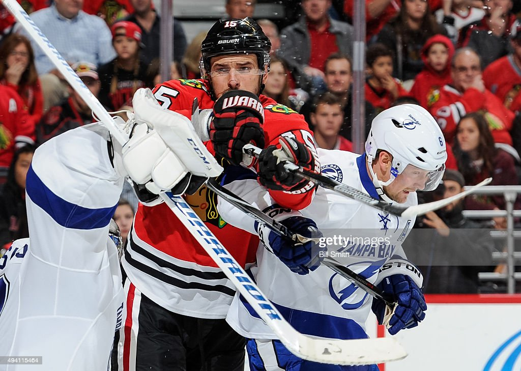 Artem Anisimov #15 of the Chicago Blackhawks and Anton Stralman #6 of the Tampa Bay Lightning get physical in the second period of the NHL game at the United Center on October 24, 2015 in Chicago, Illinois.