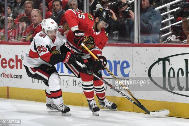 Artem Anisimov of the Chicago Blackhawks and Matt Duchene of the Ottawa Senators chase the puck in the first period at the United Center on February...