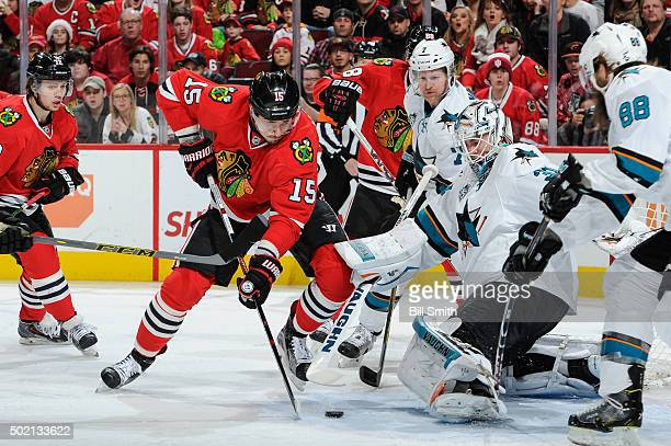 Artem Anisimov of the Chicago Blackhawks approaches the puck to shoot and score on goalie Martin Jones of the San Jose Sharks in the first period of...