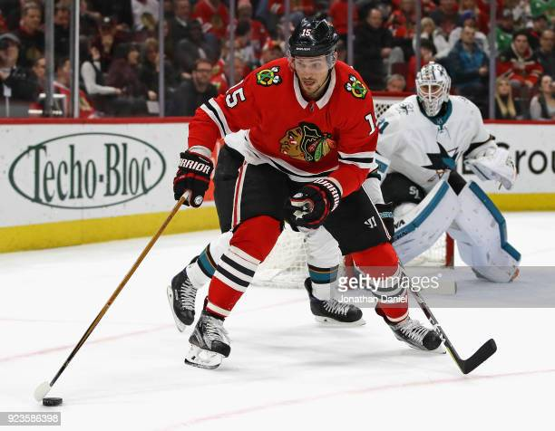 Artem Anisimov of the Chicago Blackhawks controls the puck against the San Jose Sharks at the United Center on February 23 2018 in Chicago Illinois...