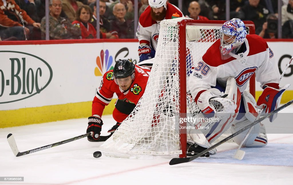 Artem Anisimov #15 of the Chicago Blackhawks falls to the ice trying to get off a shot against Charlie Lindgren #39 of the Montreal Canadiens at the United Center on November 5, 2017 in Chicago, Illinois. The Canadiens defeated the Blackhawks 2-0.