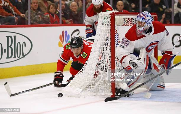 Artem Anisimov of the Chicago Blackhawks falls to the ice trying to get off a shot against Charlie Lindgren of the Montreal Canadiens at the United...