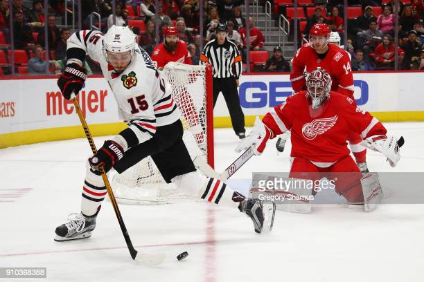 Artem Anisimov of the Chicago Blackhawks looks to shoot on Petr Mrazek of the Detroit Red Wings during the third period at Little Caesars Arena on...