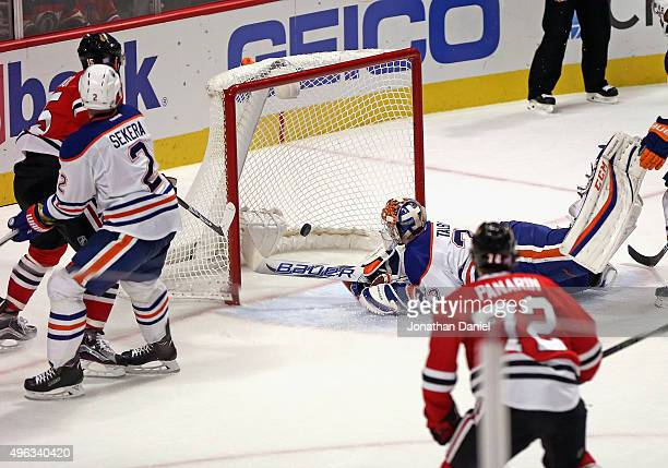 Artem Anisimov of the Chicago Blackhawks puts the puck past Cam Talbot of the Edmonton Oilers late in the third period at the United Center on...