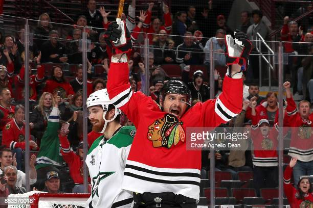 Artem Anisimov of the Chicago Blackhawks reacts after scoring against the Dallas Stars in the second period at the United Center on November 30 2017...