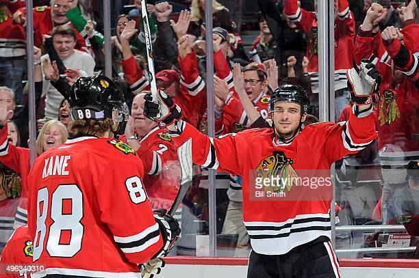 Artem Anisimov of the Chicago Blackhawks reacts after scoring an empty net goal in the third period of the NHL game against the Edmonton Oilers at...