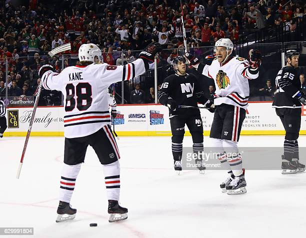 Artem Anisimov of the Chicago Blackhawks scores at 1503 of the first period against the New York Islanders and is joined by Patrick Kane at the...