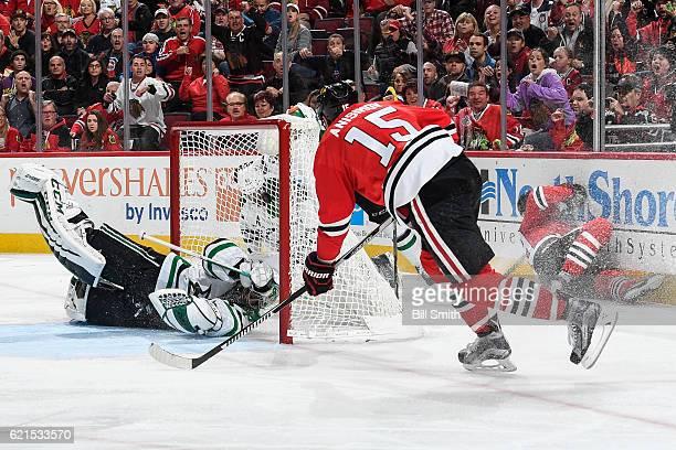 Artem Anisimov of the Chicago Blackhawks scores on goalie Kari Lehtonen of the Dallas Stars in the third period at the United Center on November 6...