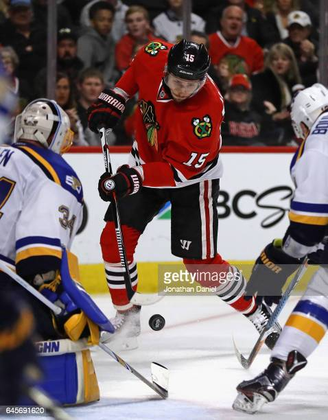 Artem Anisimov of the Chicago Blackhawks shoots and scores a third period goal against Jake Allen of the St Louis Blues at the United Center on...