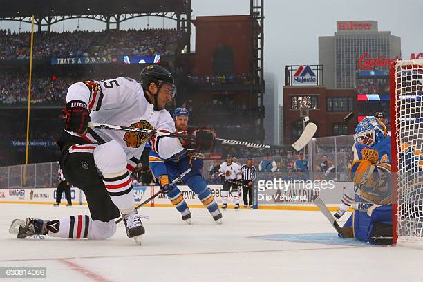 Artem Anisimov of the Chicago Blackhawks takes a shot against Jake Allen of the St Louis Blues during the 2017 Bridgestone NHL Winter Classic at...
