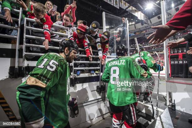 Artem Anisimov of the Chicago Blackhawks walks out to the ice in a green jersey to celebrate St Patrick's Day prior to the game against the St Louis...