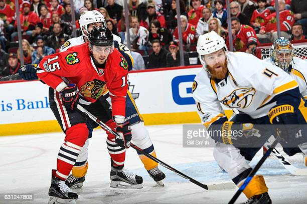 Artem Anisimov of the Chicago Blackhawks watches for the puck as Ryan Ellis of the Nashville Predators skates in the foreground in the first period...